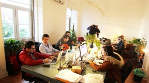 Coworkers hard at work at Cowork Central in Lisbon, Portugal